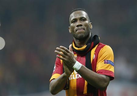 Galatasaray's Didier Drogba acknowledges the crowd as he leaves the pitch at the end of their Champions League quarter-final second leg soccer match against Real Madrid in Istanbul April 9, 2013. REUTERS/Murad Sezer/Files