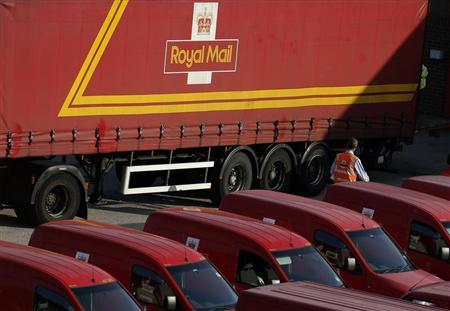 A Royal Mail postal worker walks through the car park of a sorting ofice in Altrincham, northern England July 10, 2013. REUTERS/Phil Noble