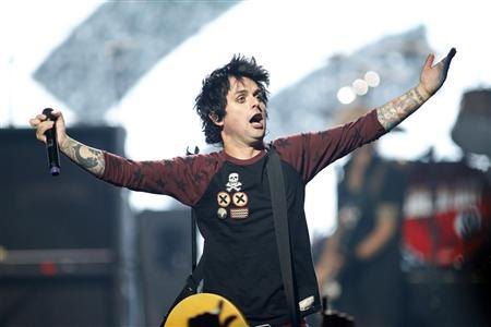 Green Day lead vocalist and guitarist Billie Joe Armstrong performs during the 2012 iHeart Radio Music Festival at the MGM Grand Garden Arena in Las Vegas, Nevada in this file photo taken September 21, 2012. REUTERS/Steve Marcus/Files