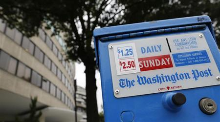 A newspaper box outside the Watergate complex offers copies of the Washington Post for sale in Washington August 6, 2013