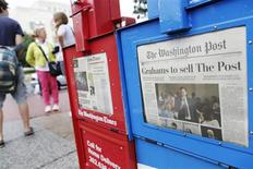 A newspaper box offers copies of the Washington Post for sale near the U.S. Capitol in Washington, August 6, 2013. REUTERS/Jonathan Ernst