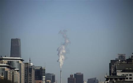 Steam billows from a chimney of a heating plant near the World Trade Centre Tower III, a 330-meter-tall (1,083 feet) skyscraper, in central Beijing February 4, 2013. REUTERS/Petar Kujundzic