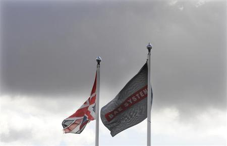 Flags fly outside the BAE Systems site in Brough, northern England October 1, 2009. REUTERS/Nigel Roddis