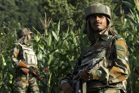 Indian army soldiers patrol near the Line of Control, a ceasefire line dividing Kashmir between India and Pakistan, in Poonch district August 7, 2013. REUTERS/Mukesh Gupta