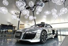 A high gloss polished new Audi R8 is pictured in the Audi Forum of the German car manufacturer's plant in Neckarsulm July 3, 2013. REUTERS/Michaela Rehle