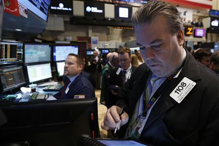Trader Robert Hannan works on the floor of the New York Stock Exchange August 7, 2013. REUTERS/Brendan McDermid