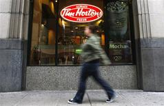 A pedestrian walks past a Tim Hortons restaurant in Toronto October 26, 2007. REUTERS/Mark Blinch