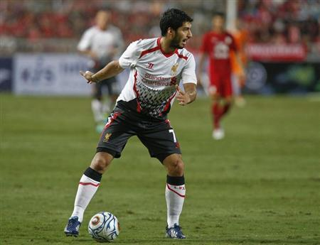 Liverpool's Luis Suarez controls the ball against Thailand's national soccer team during a friendly soccer match at Ratchamangkala Stadium in Bangkok, July 28, 2013. REUTERS/Athit Perawongmetha