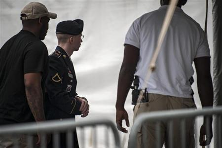 U.S. Army Private First Class Bradley Manning is escorted into court for the second day of the sentencing phase in his military trial at Fort Meade, Maryland August 1, 2013. REUTERS/James Lawler Duggan
