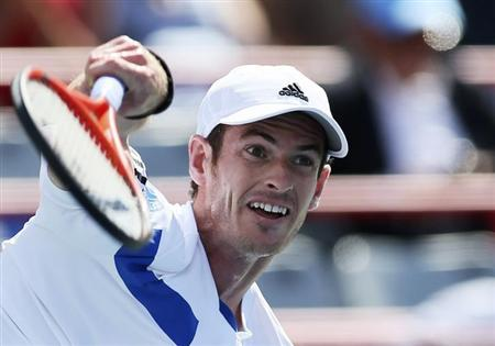 Andy Murray of Britain serves to Ernests Gulbis of Latvia at the Rogers Cup tennis tournament in Montreal, August 8, 2013. REUTERS/Christinne Muschi