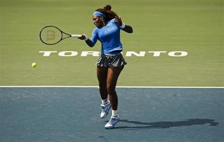 Serena Williams of the U.S. hits a return to Kirsten Flipkens of Belgium during their women's tennis match at day four of the Rogers Cup tennis tournament in Toronto, August 8, 2013. REUTERS/Mark Blinch