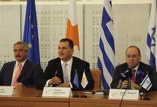 Ministers of Energy for Greece, Cyprus and Israel (L-R) Yannis Maniatis, Yiorgos Lakkotrypis and Silvan Shalom attend the signing of a memorandum of understanding in Nicosia, Cyprus Thursday August 8, 2013. REUTERS/Andreas Manolis.