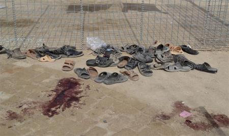 Footwear is seen near a pool of blood at the site of gun battle in Quetta August 9, 2013. REUTERS/Naseer Ahmed
