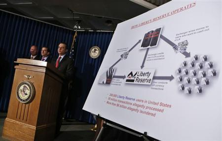 Preet Bharara, United States Attorney for the Southern District of New York, describes charges against Costa Rica-based Liberty Reserve, one of the worlds largest digital currency companies and seven of it's principals and employees for allegedly running a $6 billion money laundering scheme at a news conference in New York, May 28, 2013. REUTERS/Mike Segar