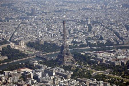 An aerial view shows the Eiffel Tower (C), the Seine River and the Paris skyline on July 14, 2013. REUTERS/Charles Platiau