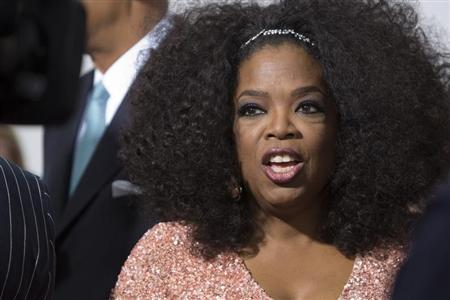 Cast member Oprah Winfrey attends director Lee Daniels' 'The Butler' New York film premiere at the Ziegfeld Theater in New York August 5, 2013. REUTERS/Andrew Kelly