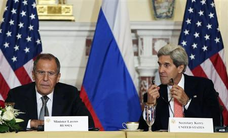United States Secretary of State John Kerry (R) listens to Russian Foreign Minister Sergey Lavrov at a press briefing at the State Department in Washington before a day of talks August 9, 2013. REUTERS/Gary Cameron