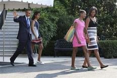 U.S. President Barack Obama (L) waves as he and his wife Michelle (R) and daughters Malia (2nd L) and Sasha (2nd R) depart for travel to Africa, from the South Lawn of the White House in Washington, June 26, 2013 file photo. REUTERS/Jonathan Ernst