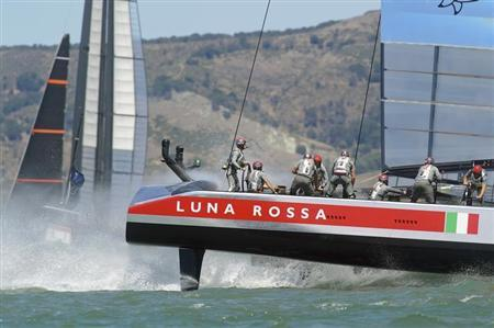 Italy's Luna Rossa Challenge (R) passes Sweden's Artemis Racing during Race 4 of their Louis Vuitton Cup semi-finals in San Francisco, California August 10, 2013. REUTERS/Noah Berger