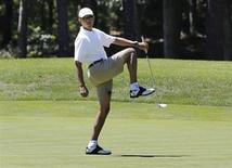 U.S. President Barack Obama reacts after missing a putt on the first green at the Farm Neck Golf Club at Oak Bluffs on Martha's Vineyard, August 11, 2013. REUTERS/Larry Downing
