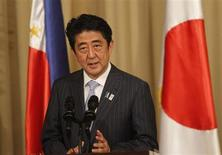 Japanese Prime Minister Shinzo Abe speaks during his joint press statement with Philippine President Benigno Aquino at the presidential palace in Manila July 27, 2013. REUTERS/Romeo Ranoco