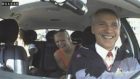 Norwegian Prime Minister Jens Stoltenberg and two passengers laugh, after they realised he was driving a taxi in Oslo, in this still image taken from video provided by the Norwegian Labour Party on August 11, 2013. REUTERS/Norwegian Labour Party via NTB Scanpix
