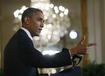 Президент США Барак Обама выступает на пресс-конференции в Вашингтоне 9 августа 2013 года. США сделают паузу для переоценки и калибровки отношений с Россией, приняв во внимание те вопросы, по которым страны могут договориться и те, где между ними существуют разногласия, сказал на пресс-конференции в пятницу вечером Барак Обама. REUTERS/Jason Reed