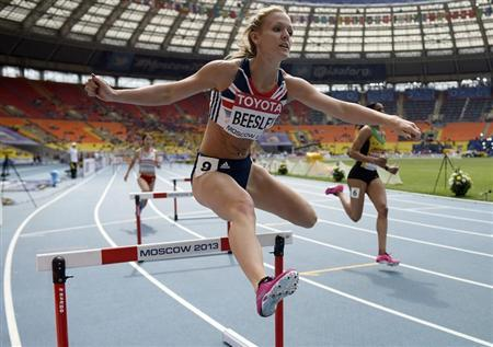 Meghan Beesley of Britain competes in the women's 400 metres hurdles heat during the IAAF World Athletics Championships at the Luzhniki Stadium in Moscow August 12, 2013. REUTERS/Dylan Martinez