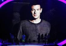 "Actress Lea Michele walks off stage with ""Glee"" co-stars Jenna Ushkowitz, Amber Riley and Kevin McHale after accepting the Choice TV Actress: Comedy Award, as a photo of the late Cory Monteith is projected on a screen at the Teen Choice Awards at the Gibson amphitheatre in Universal City, California August 11, 2013. Michele dedicated her 2013 Teen Choice Award for Choice TV Comedy Actress to late castmate and boyfriend Monteith during a tearful acceptance speech Sunday in Los Angeles. REUTERS/Mario Anzuoni"