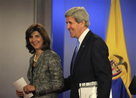 U.S. Secretary of State John Kerry smiles with Colombia's Foreign Minister Maria Angela Holguin after a news conference at the presidential palace in Bogota August 12, 2013. REUTERS/Jose Miguel Gomez