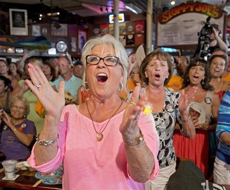 Food Network television personality Paula Deen cheers for her husband Michael Groover during the semi-finals of the ''Papa'' Hemingway Look-Alike Contest at Sloppy Joe's Bar in Key West, Florida July 21, 2012. REUTERS/Andy Newman/Florida Keys News Bureau/Handout