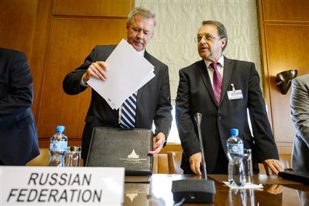 Russia Deputy Minister for Foreign Affairs Mikhail Bogdanov (L) and Deputy Minister for Foreign Affairs Gennady Gatilov prepare for a meeting on Syria at the United Nations European headquarters in Geneva June 25, 2013. REUTERS/Fabrice Coffrini