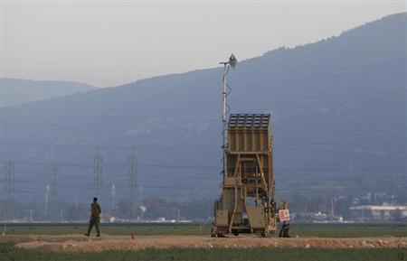 An Israeli soldier walks away from an Iron Dome rocket interceptor battery deployed near the northern Israeli city of Haifa May 5, 2013. REUTERS/Baz Ratner