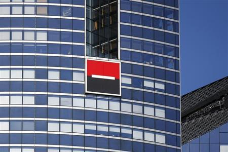 The logo of French bank Societe Generale is seen on a building in the financial district of La Defense near Paris August 1, 2013. REUTERS/Benoit Tessier