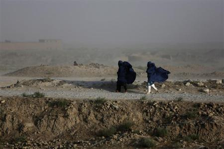 Women walk on a windy day outside Kabul July 23, 2013. REUTERS/Mohammad Ismail