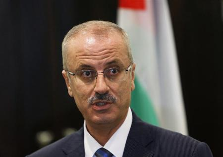 Palestinian Prime Minister Rami Hamdallah speaks during a joint news conference with European Union foreign policy chief Catherine Ashton (not pictured) in the West Bank city of Ramallah in this June 19, 2013 file photo. REUTERS/Mohamad Torokman