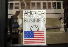 A sign is shown in the window of a retail store in San Francisco, California in this file photo taken May 13, 2013. REUTERS/Robert Galbraith/Files