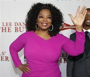 "Actress Oprah Winfrey, a cast member of the film ""Lee Daniels' The Butler"", poses at the film's premiere in Los Angeles August 12, 2013. REUTERS/Fred Prouser"