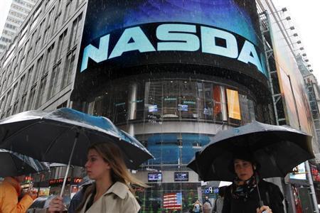Commuters pass by the NASDAQ Marketsite in New York, May 21, 2012. REUTERS/Brendan McDermid