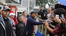 U.S. President Barack Obama shakes hands before ordering lunch at Nancy's restaurant at Oak Bluffs at Martha's Vineyard, August 13, 2013. REUTERS/Larry Downing