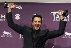 Luke Bryan poses with his awards for entertainer of the year and vocal event of the year at the 48th ACM Awards in Las Vegas April 7, 2013 file photo. REUTERS/Steve Marcus