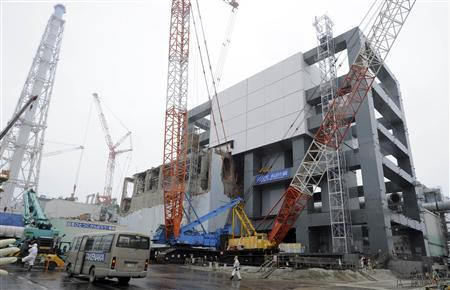 A general view of the cover installation for the spent fuel removed from the cooling pool at the No.4 reactor building at Tokyo Electric Power Company's (TEPCO) tsunami-crippled Fukushima Daiichi nuclear power plant in Fukushima prefecture in this June 12, 2013 file photo. REUTERS/Toshifumi Kitamura/Pool/Files