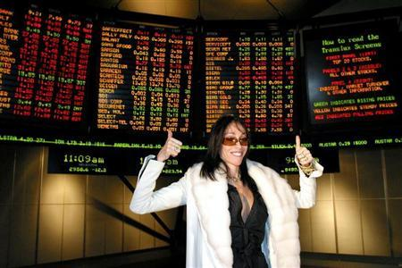 Hollywood Madam Heidi Fleiss poses for photographers at the Australian Stock Exchange in Melbourne May 1, 2003 after the brothel known as 'The Daily Planet' became the world's first officially listed bordello.