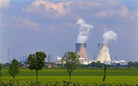 Steam billows from the cooling towers of a nuclear plant in Doel, near Antwerp June 5, 2013. REUTERS/Yves Herman