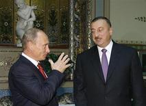 Премьер-министр России Владимир Путин на встрече с президентом Азербайджана Ильгамом Алиевым в Москве 16 сентября 2008 года. Владимир Путин не сумел заручиться конкретными сделками в энергетике в ходе одной из нечастых поездок в Азербайджан, где в нефтегазовом секторе доминируют западные гиганты. REUTERS/RIA Novosti/Pool