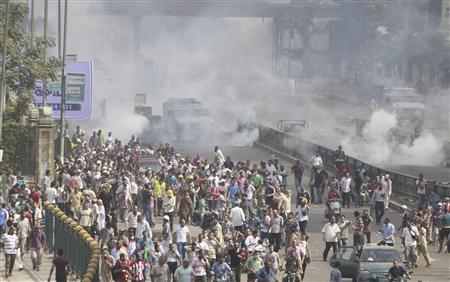 Riot police vehicles fire tear gas at members of the Muslim Brotherhood and supporters of deposed Egyptian President Mohamed Mursi, around Cairo University and Nahdet Misr Square, where they are camping in Giza, south of Cairo August 14, 2013. REUTERS-Mohamed Abd El Ghany