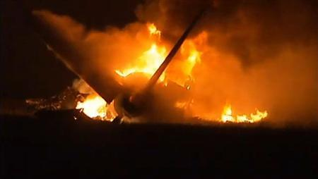 Flames rise from a UPS Airbus A300 cargo plane which crashed near the airport in Birmingham, Alabama August 14, 2013 in this still image from video courtesy of TV station Alabama's 13. REUTERS/Alabama's 13/Handout via Reuters