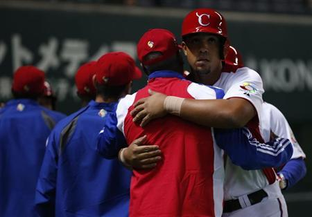 Cuba's Jose Abreu reacts with teammates after hitting a grand slam off China's Liu Yu in the fifth inning at the World Baseball Classic (WBC) qualifying first round game in Fukuoka, southern Japan March 4, 2013. REUTERS/Toru Hanai