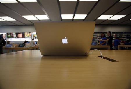A MacBook Air laptop is pictured on display at an Apple Store in Pasadena, California July 22, 2013.REUTERS/Mario Anzuoni
