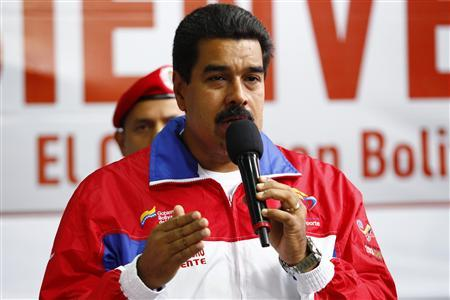 Venezuela's President Nicolas Maduro speaks during the inauguration of a funicular at Petare slum in Caracas August 14, 2013. REUTERS/Carlos Garcia Rawlins